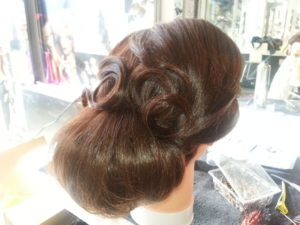 Low bun with sculpted pin-curls